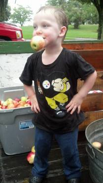 My grandson; so proud of his successful apple bob!